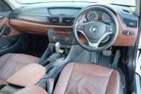 X series: 2014 BMW X1 2.0 MATIC Executive putih Bensin Terawat TDP 62 JT (75e64972-866d-4651-a525-f3e19ca63e0a.jpg)