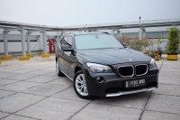 Jual X series: 2011 BMW X1 2.0 MATIC Bensin HITAM bagus antik murah TDP 69JUTA