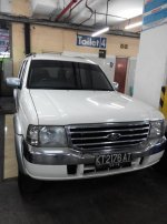 DiJual Ford Everest 2,5 diesel Xlt 4x4 Manual Tahun 2006 Putih (depan2.jpg)