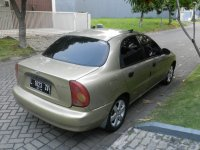 KIA Daewo Lanos (bukan KIA): Jual Cepat Mobil Sedan Daewo Lanos (Daewo samping belakang.JPG)