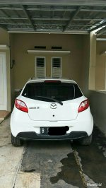 Jual mobil second mazda 2 white (PhotoGrid_1521772449778.jpg)