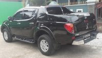 Mitsubishi STRADA Triton 2.5 GLS DC Th2013 Manual (black2.jpg)