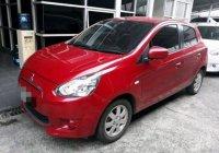 Jual harga mobil Mitsubishi Mirage 2012 merah Exceed AT